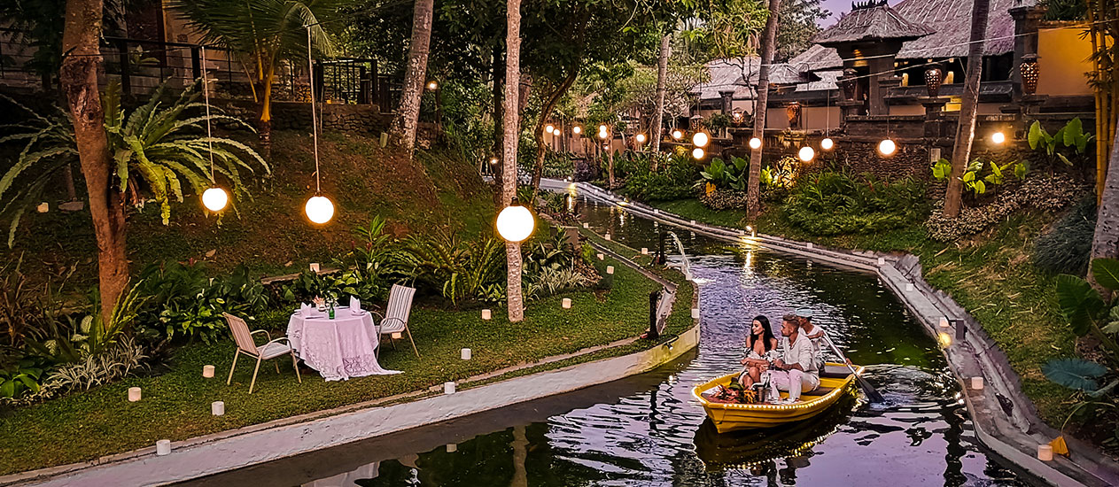 Intimate Boat Dining in the lagoon with tropical garden, Romantic Dinner Experience, Kamandalu Ubud, Bali