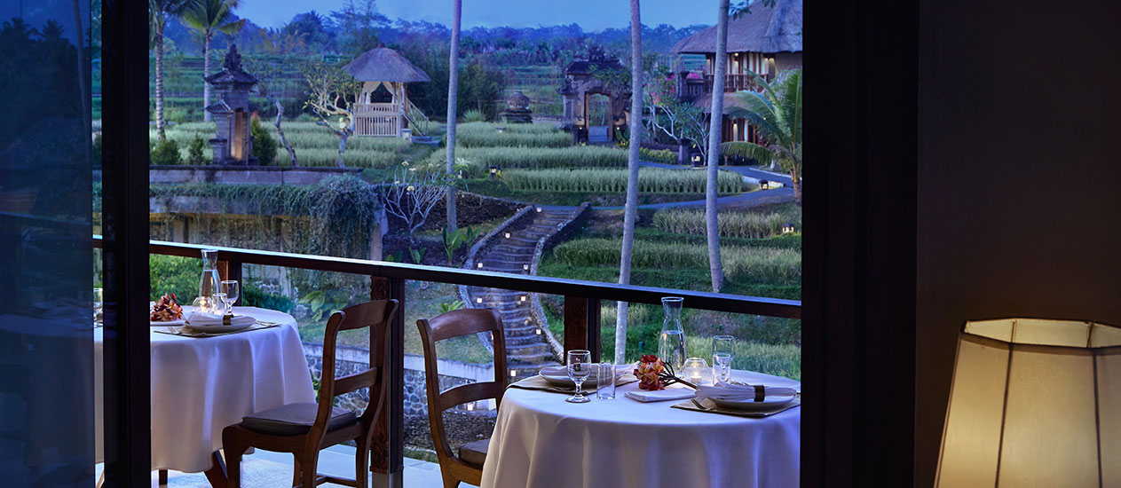 Petulu Restaurant at Kamandalu Ubud overlooking terraced rice paddies and tropical landscape Ubud. Petulu Restaurant is savor a mouthwatering selection of authentic Indonesian Archipelago cuisine against a stunning backdrop of rice paddies.
